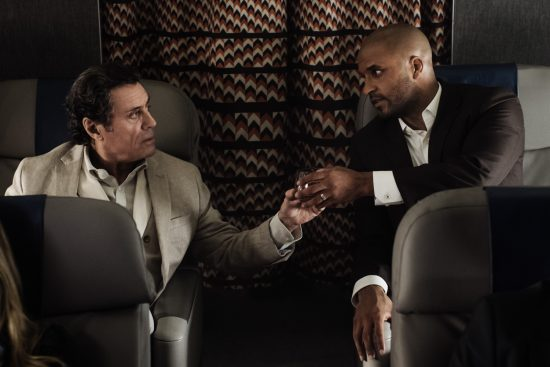 American Gods 1x01 Ian McShane as Mr. Wednesday and Ricky Whittle as Shadow Moon